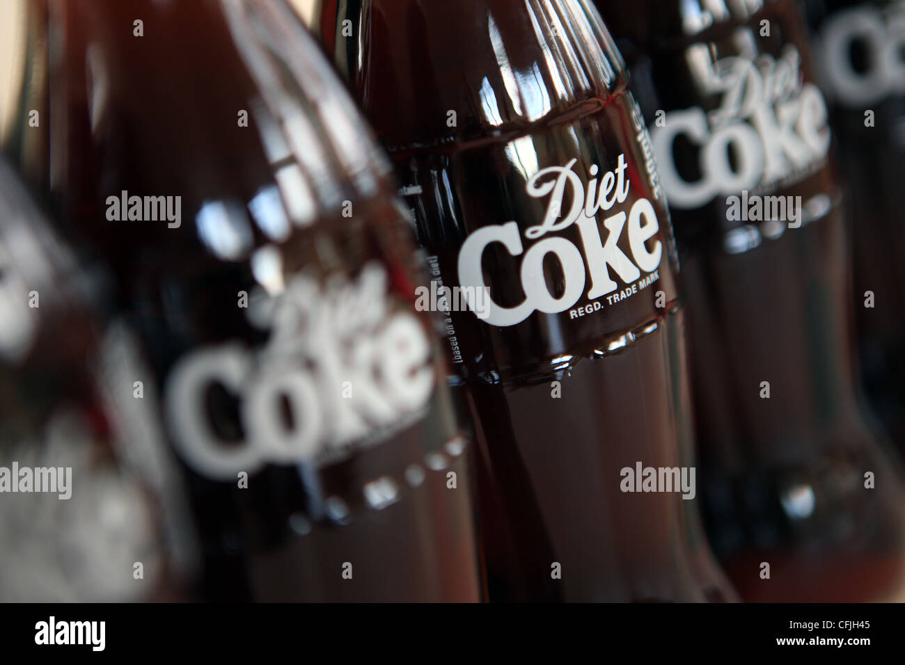 Diet Coke bottles in a row - Stock Image