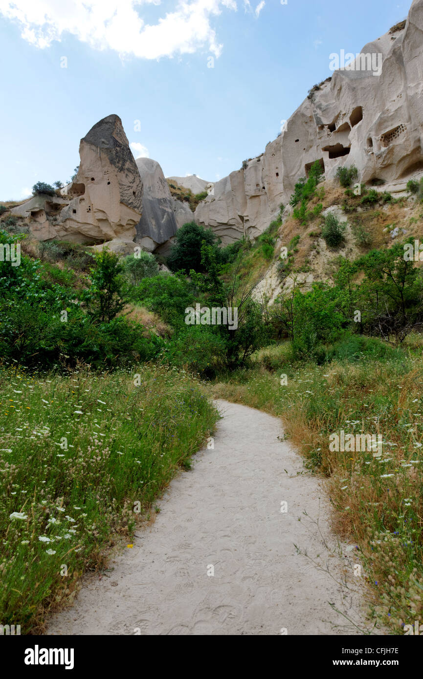 Cappadocia. Turkey. View along the Rose valley pathway with dovecotes hollowed into the volcanic rock tuff in the Stock Photo