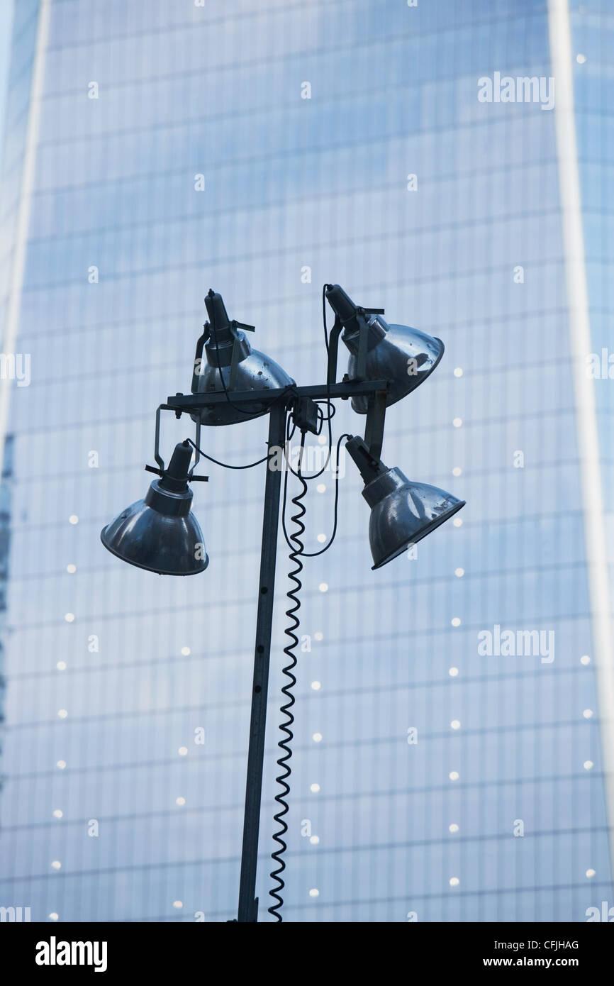 Street light and skyscraper - Stock Image