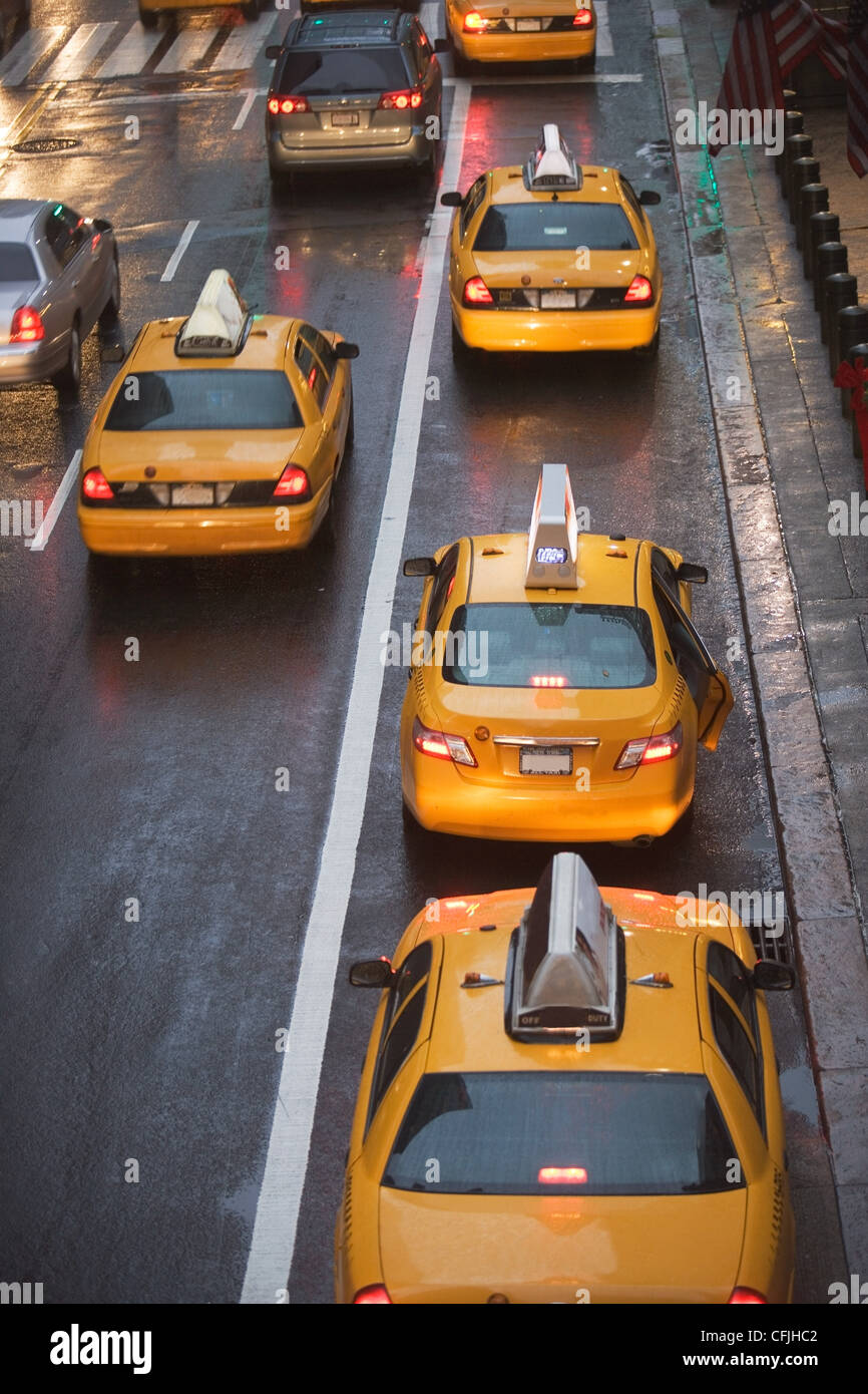 Taxicabs in New York City traffic, USA - Stock Image