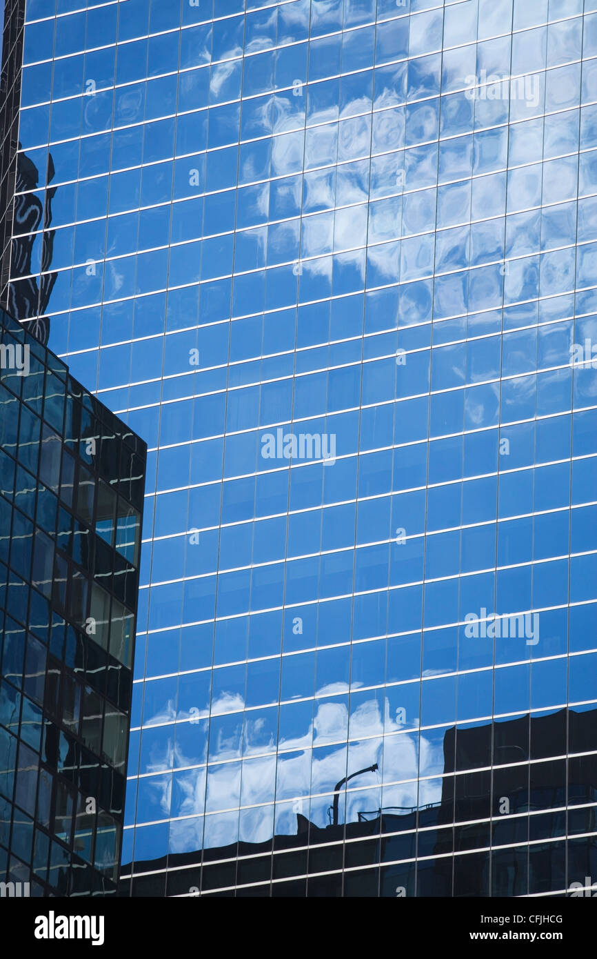 Reflections in glass building - Stock Image