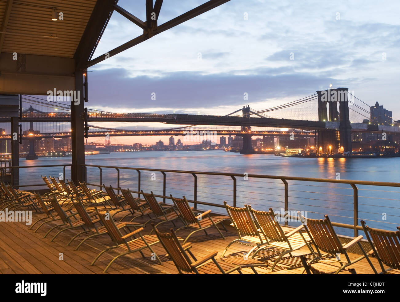 Deckchairs overlooking East River, New York City, USA - Stock Image