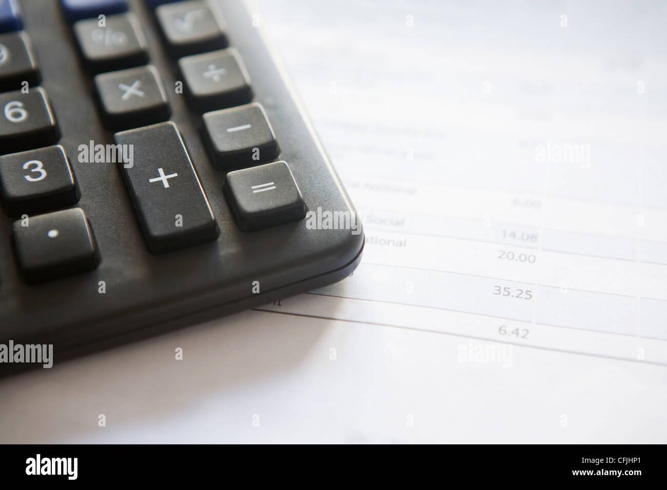Calculator and bill - Stock Image