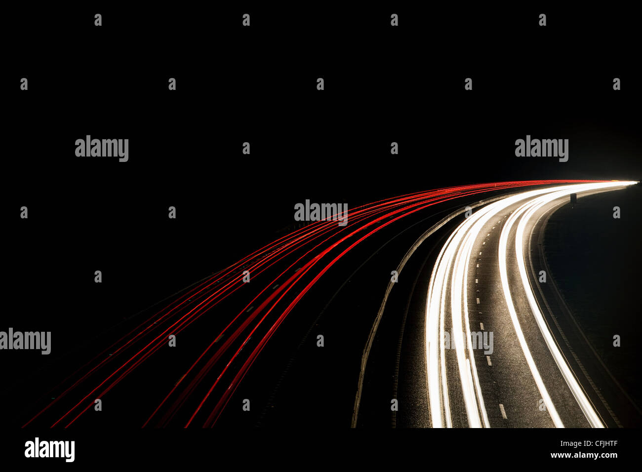 Headlights and tail lights on motorway - Stock Image