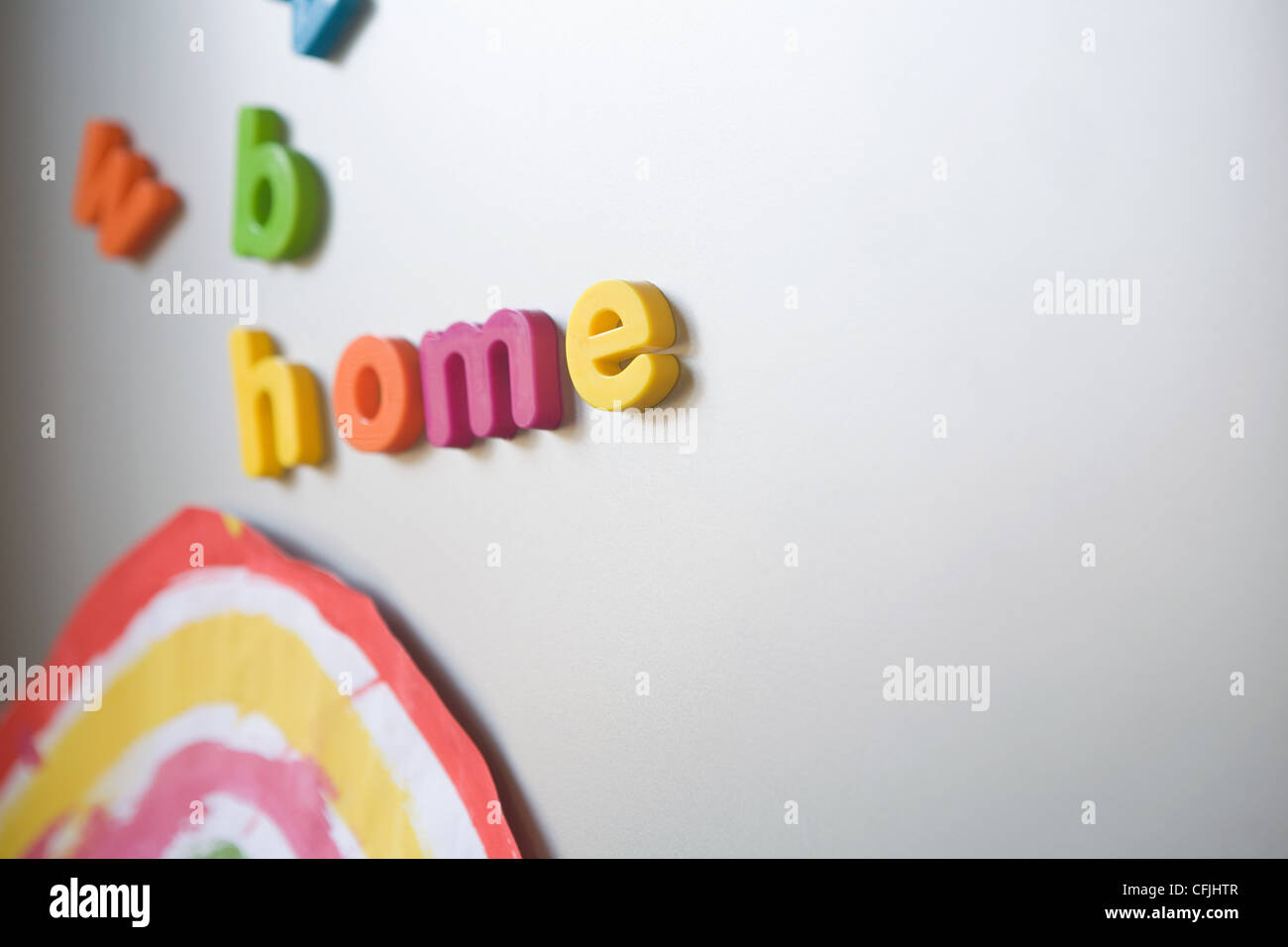 Letters spelling 'home' on family refrigerator - Stock Image