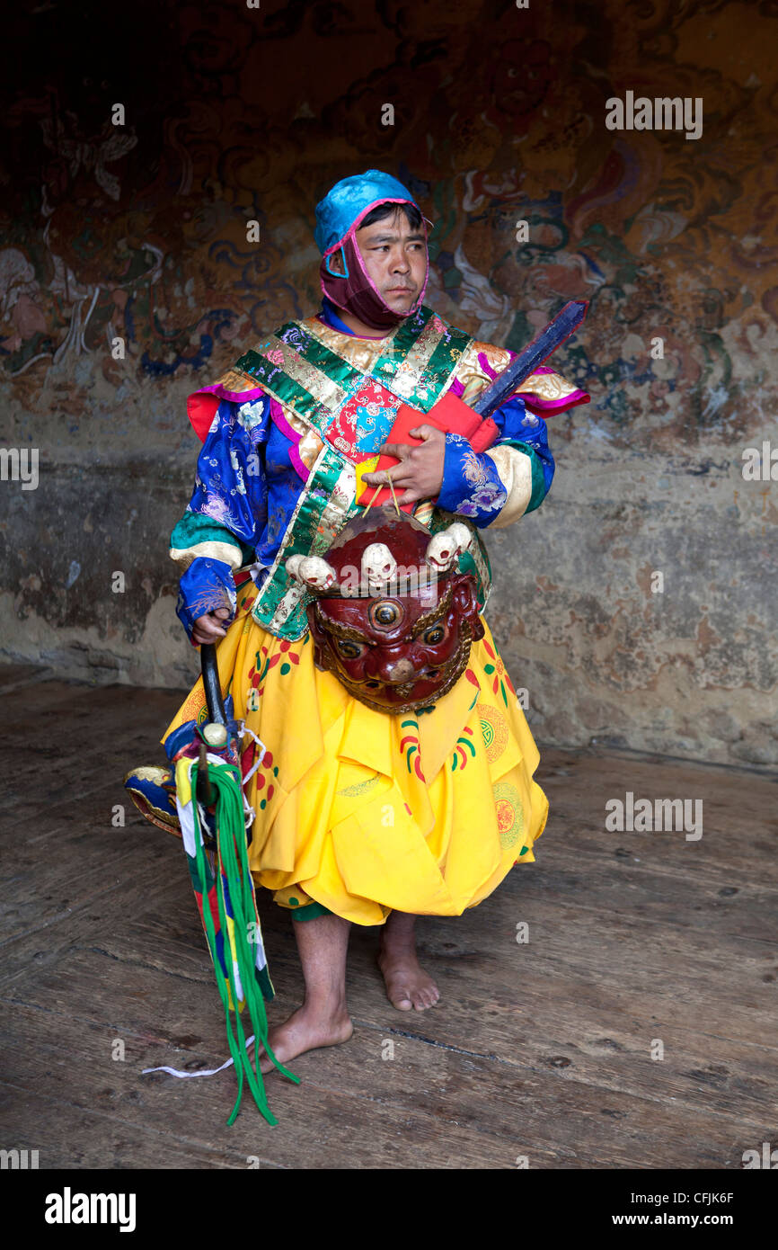 Buddhist monk in colourful costume, Jakar, Bumthang, Bhutan, Asia - Stock Image
