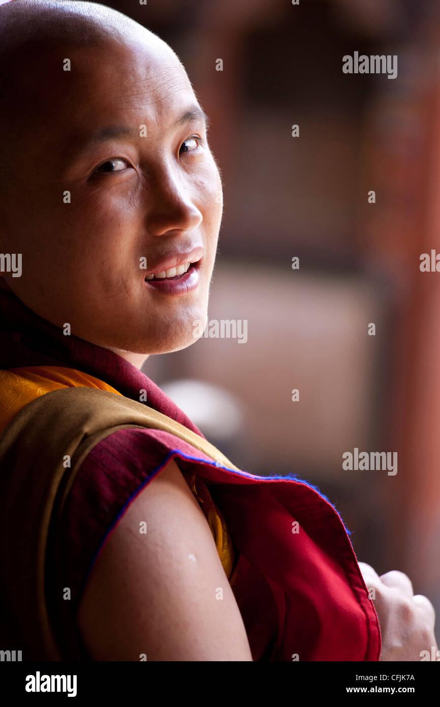 Portrait of Buddhist monk at the Tamshing Phala Choepa Tsechu, near Jakar, Bumthang, Bhutan, Asia - Stock Image
