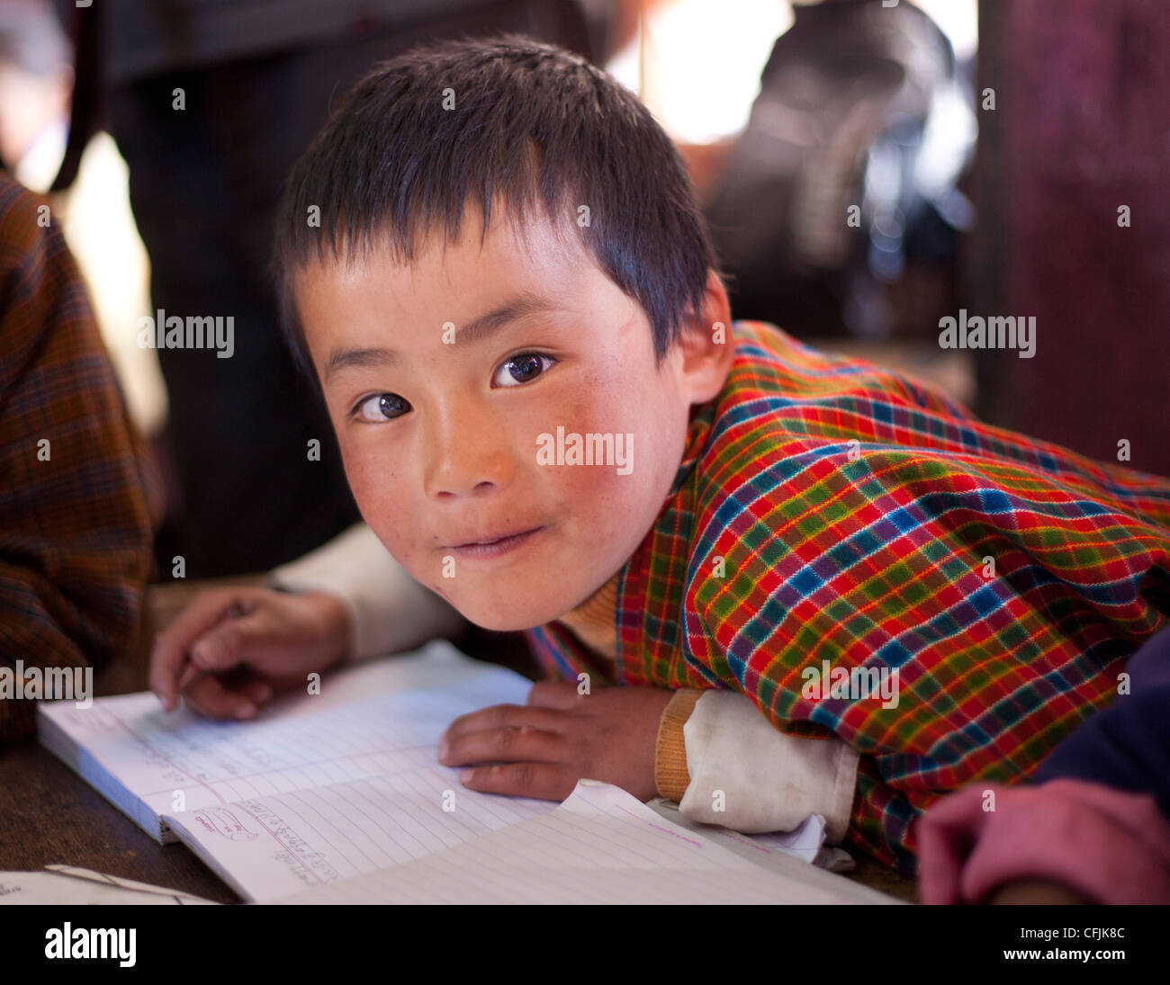 Young boy at his school in Ura Village, Ura Valley, Bumthang, Bhutan, Asia - Stock Image