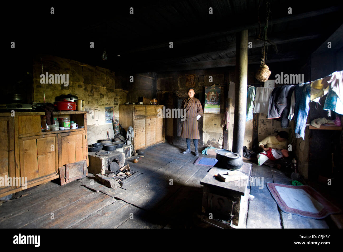 Local man with his wife and bady, Jakar, Bumthang, Bhutan, Asia - Stock Image