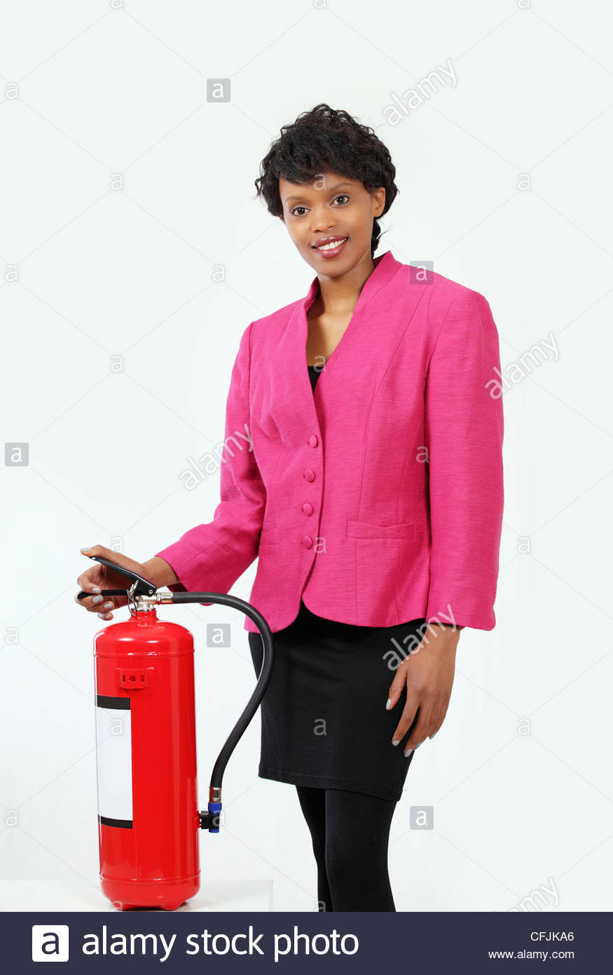 Woman presenting fire extinguisher - Stock Image
