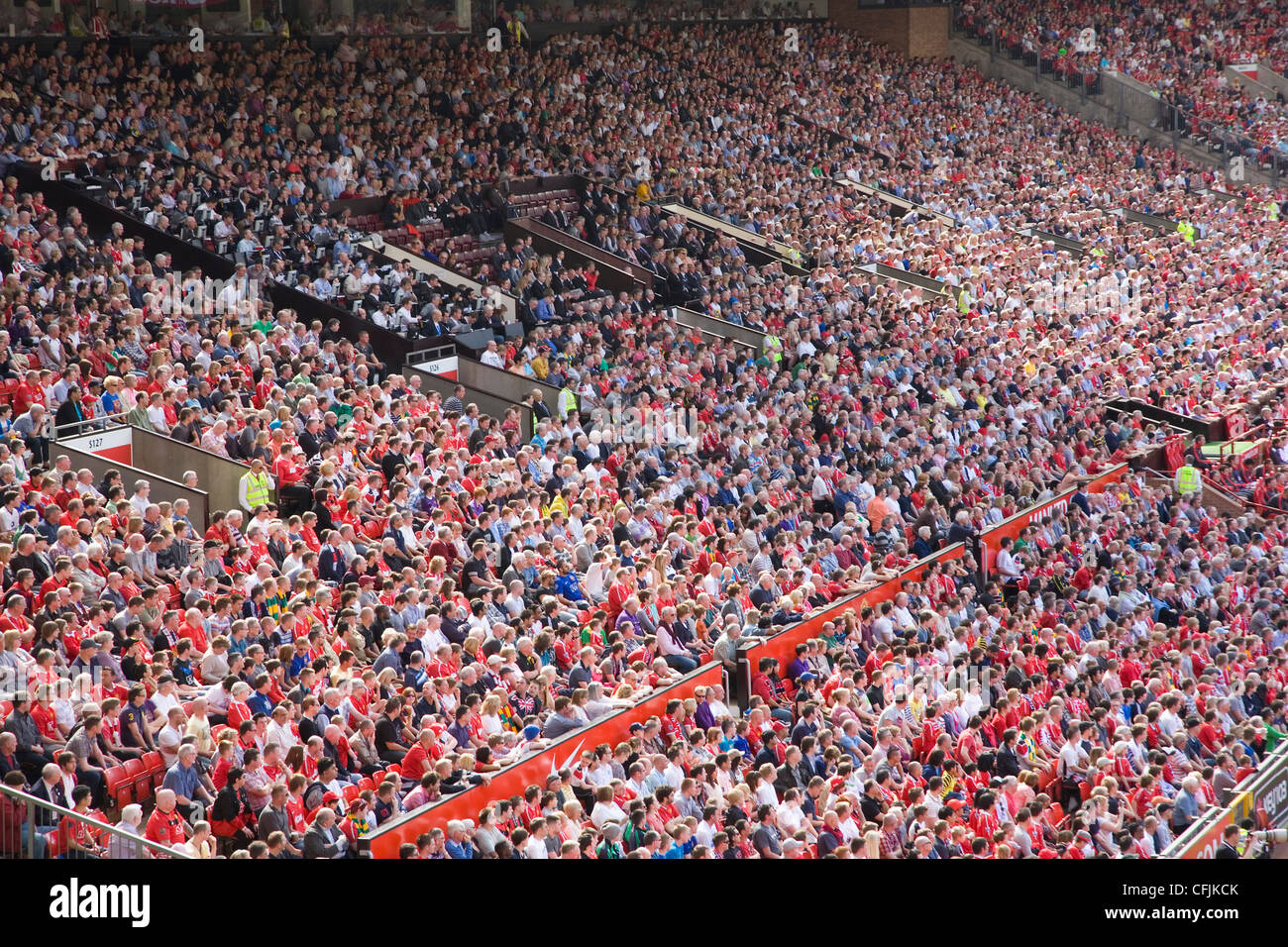 Crowds at English Premiership football match, Manchester, England, United Kingdom, Europe - Stock Image