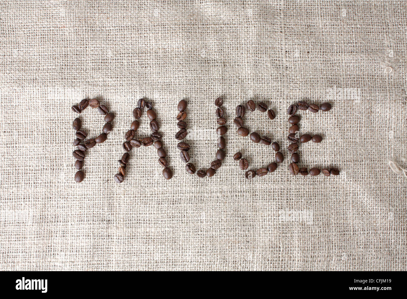 Pause spelled by coffee beans - Stock Image