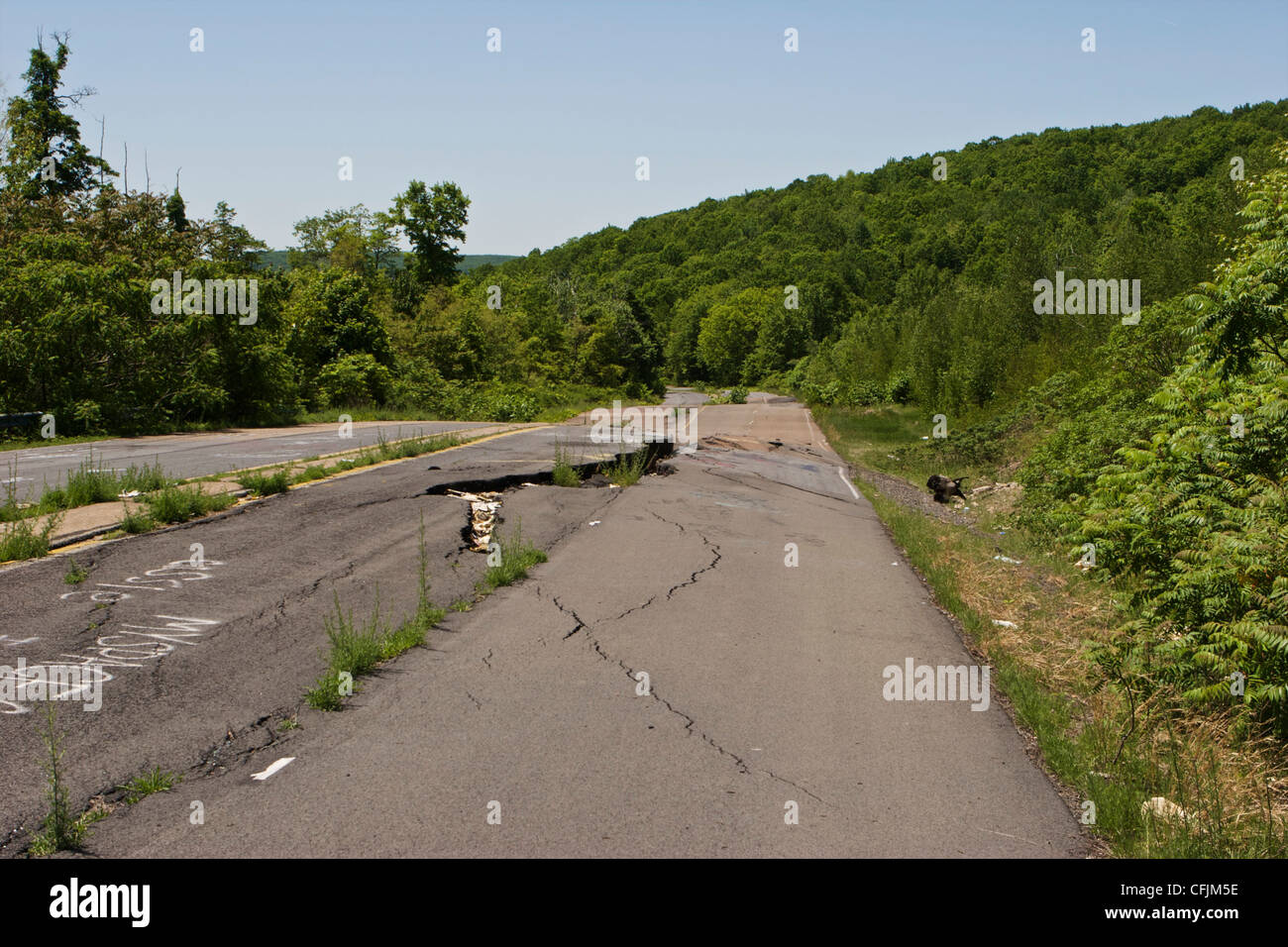 Closed section of PA Route 61 near Centralia warped and with fissures due to underground coal mine fire. - Stock Image