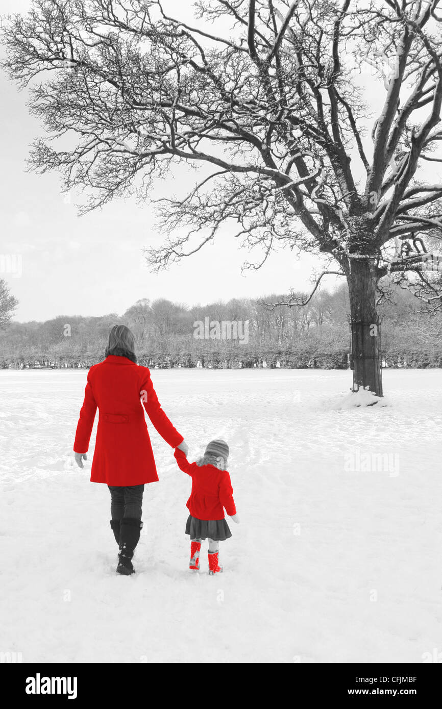 winter Christmas card snow scene mother & daughter red coats and ...