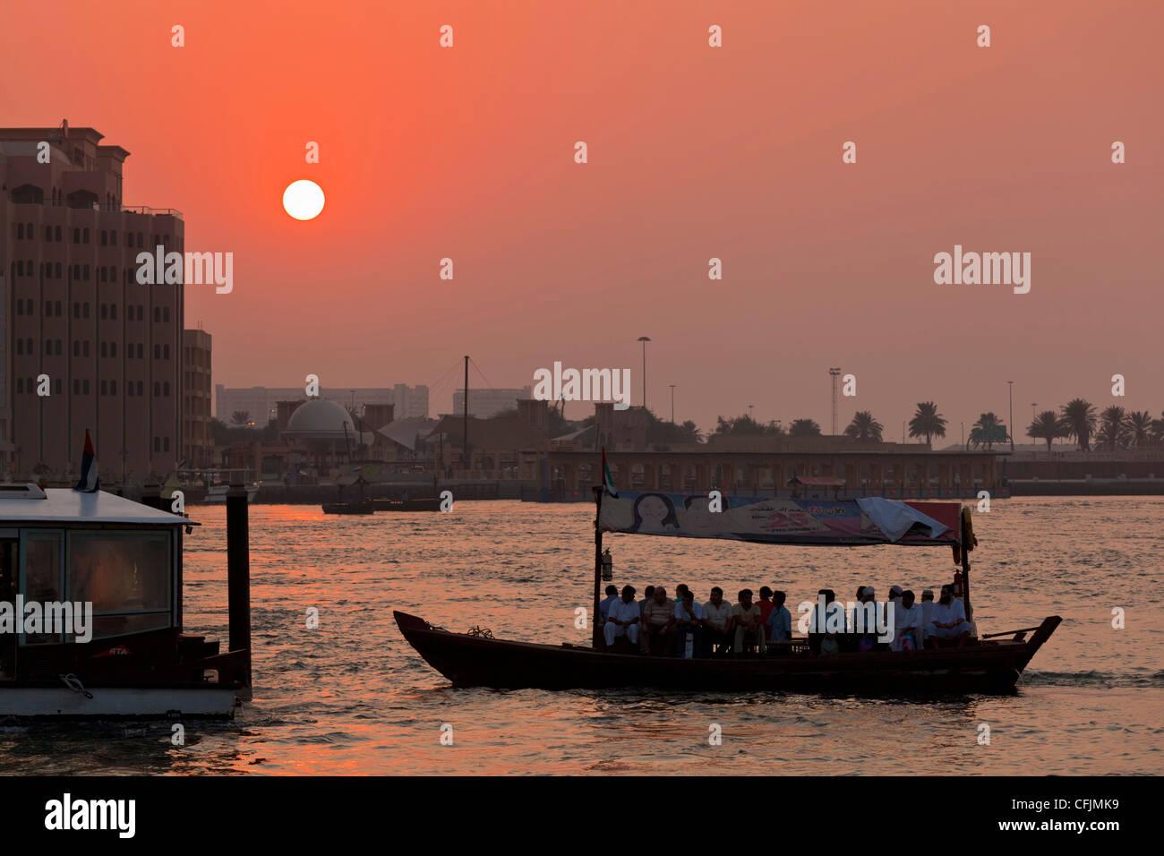 Abra Water taxi, Dubai Creek at sunset, Bur Dubai, Dubai, United Arab Emirates, Middle East - Stock Image