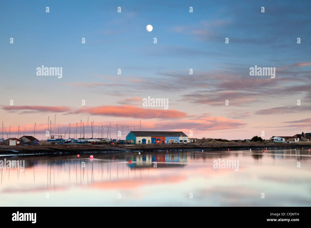 Moon rising over the Royal Findhorn Yacht Club, on the Moray Firth, Scotland. - Stock Image