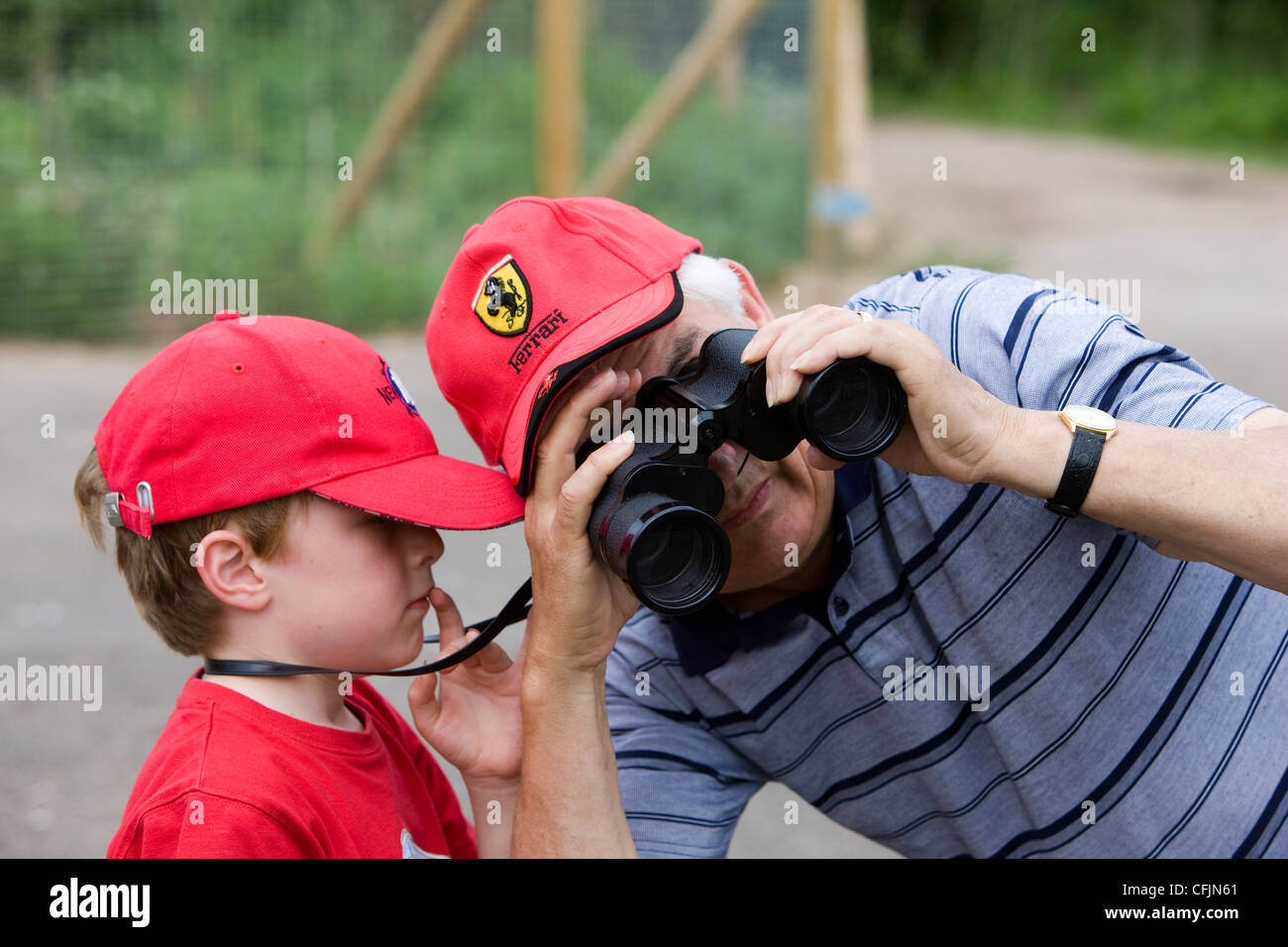 4f5f598880ffb Borrowing the binoculars at WWT Slimbridge Stock Photo  44052345 - Alamy