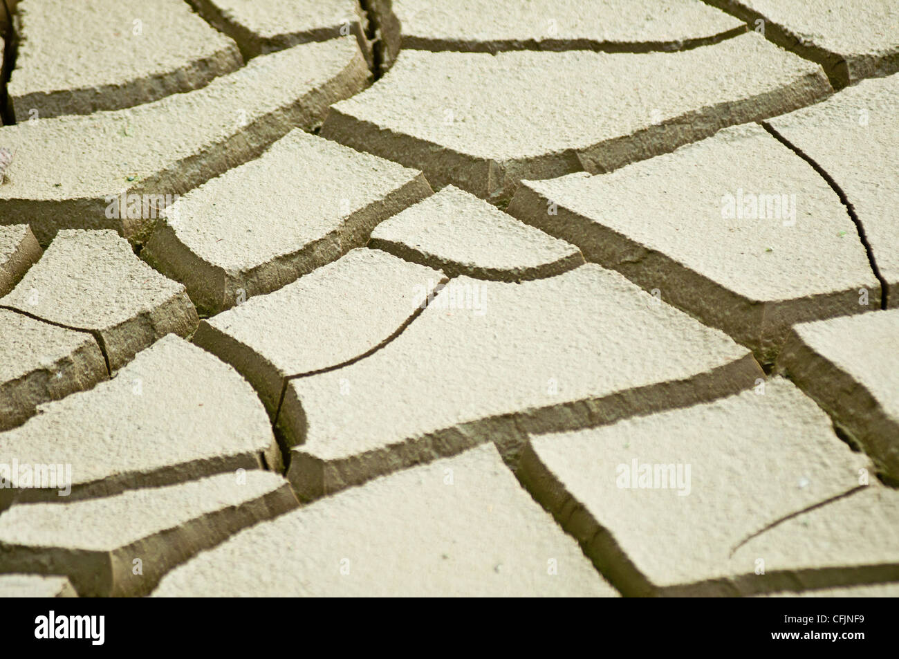 Dry heavy cracked Earth as a result of drought, parched mud, - Stock Image