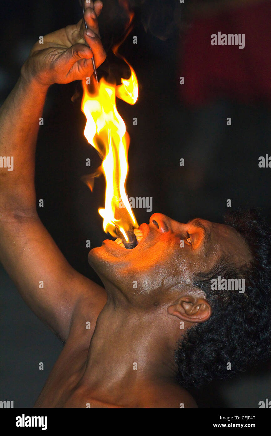 Man eating fire during the Fire Walking at a Kandyan dance show in the Kandyan Arts Association Hall, Kandy, Sri - Stock Image