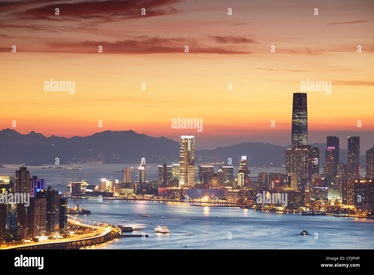 Tsim Sha Tsui skyline at sunset, Hong Kong, China, Asia - Stock Image