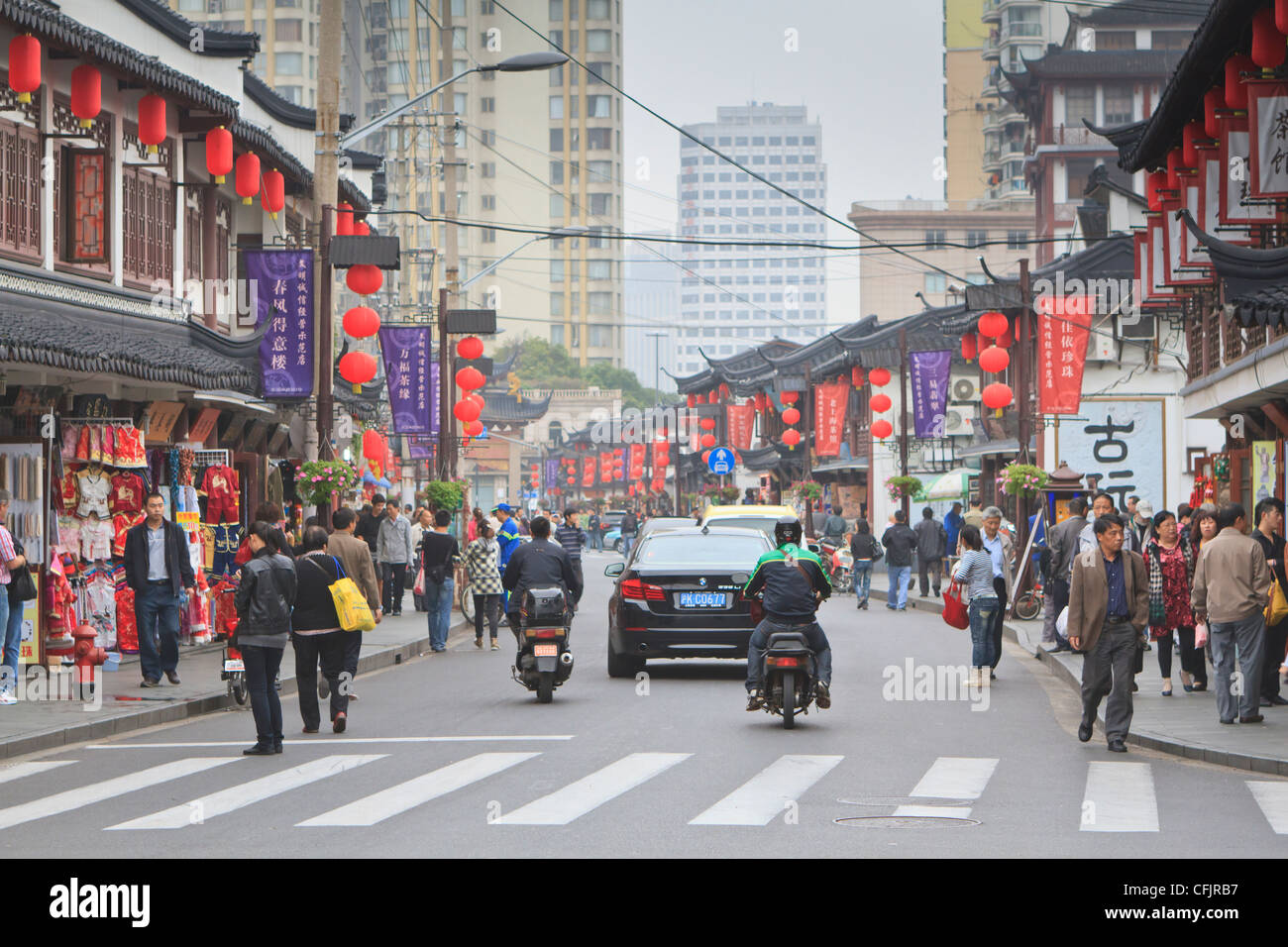 Pedestrians and traffic on Shanghai Old Street, remnant of a bygone age, Fuxing, Shanghai, China, Asia Stock Photo