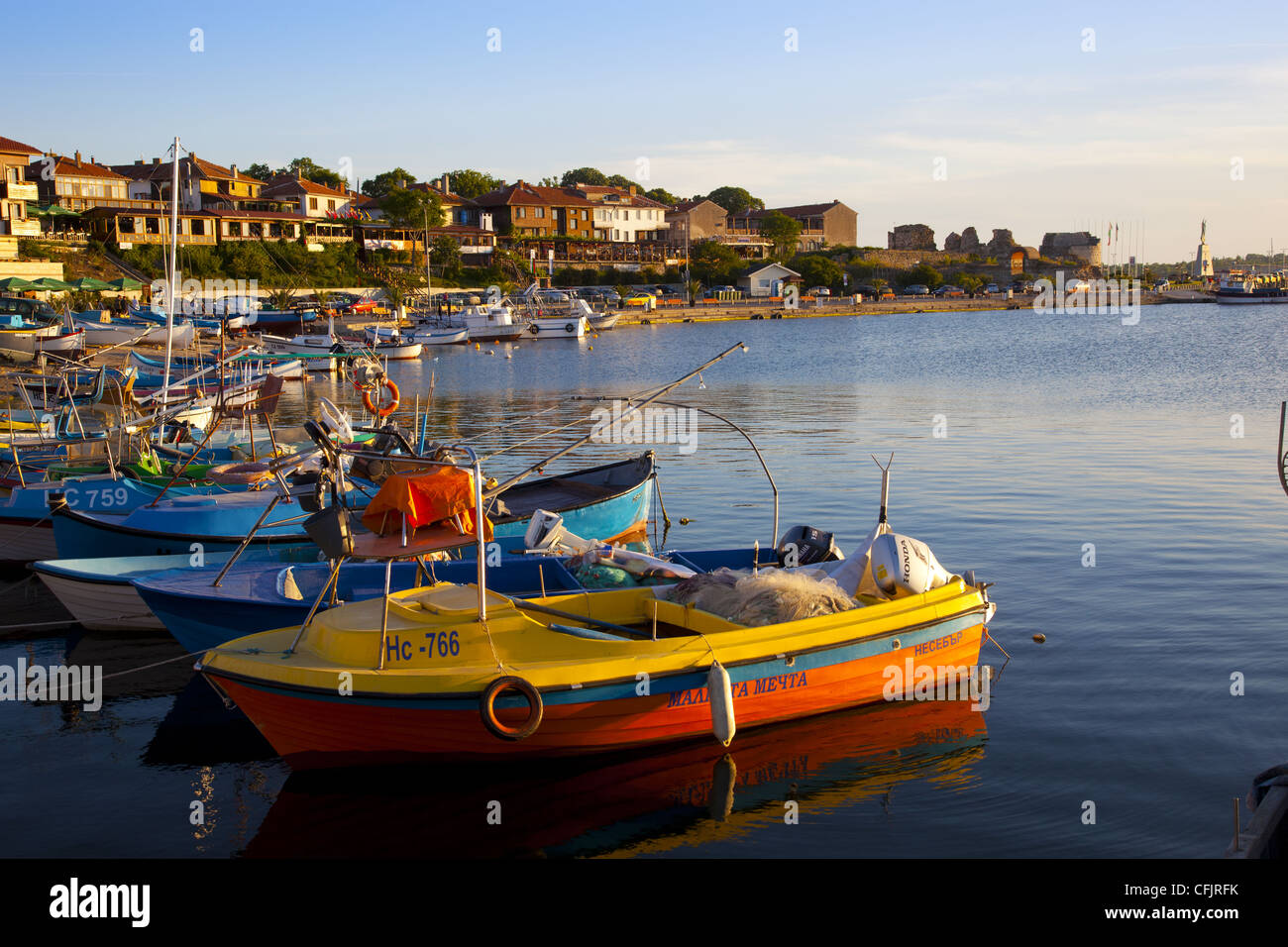 Fishing boats and view towards ramparts and ruins of the medieval fortification walls, Nessebar, Black Sea, Bulgaria, - Stock Image