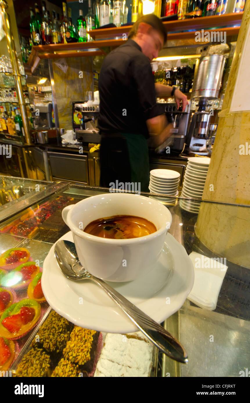 Caffe espresso on a counter of cakes, Venice, Veneto, Italy, Europe - Stock Image