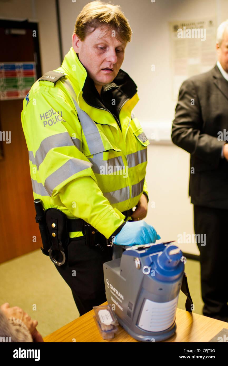 a uniformed police officer calibrating an SAFRAN morpho
