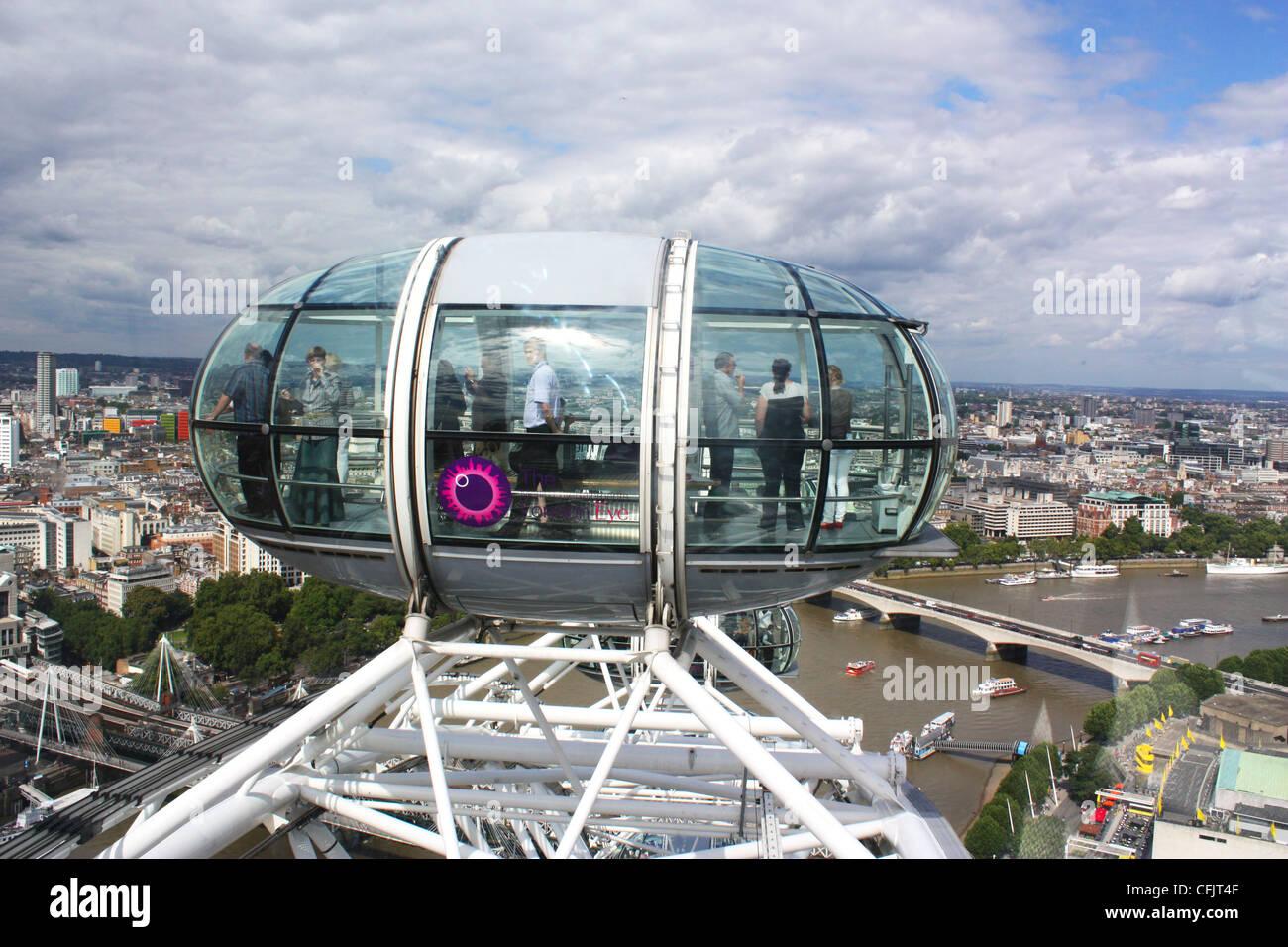 London Eye capsule over river Thames in UK Stock Photo