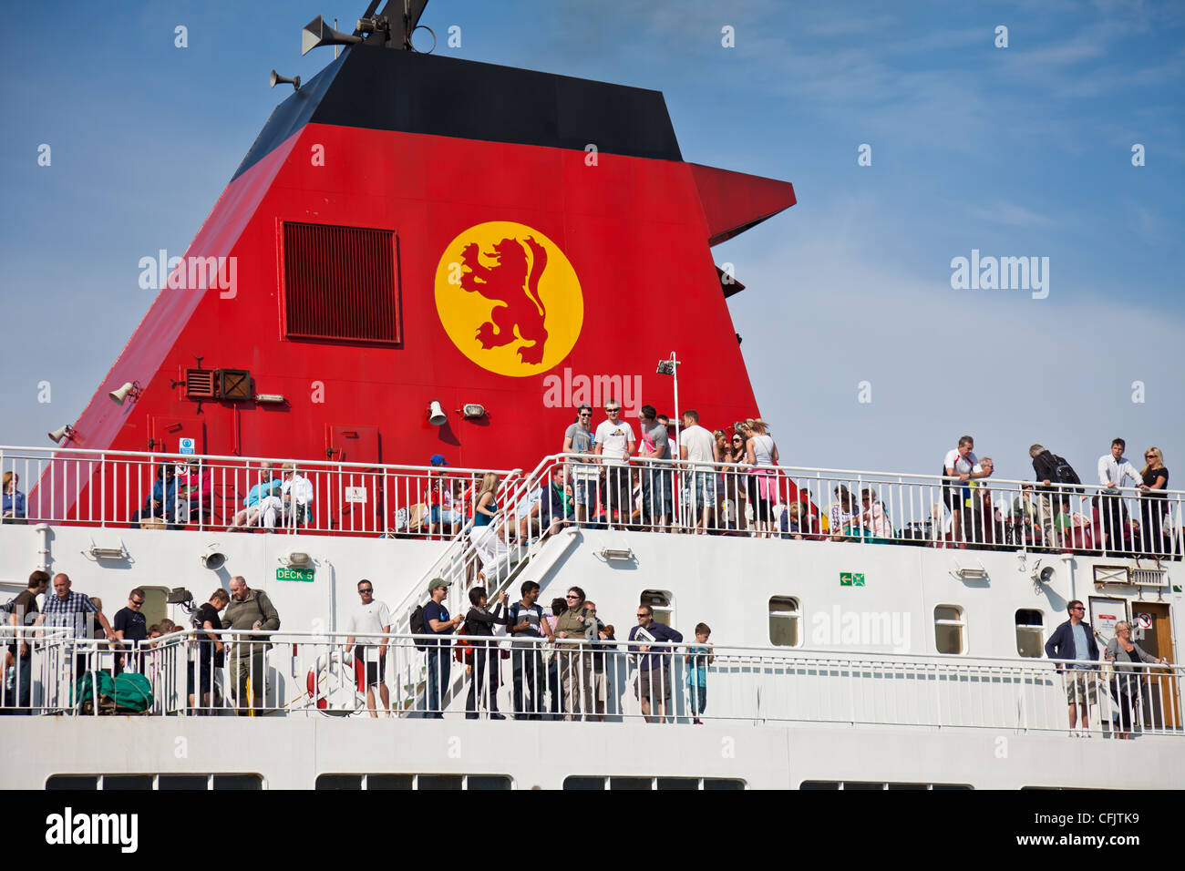 Passengers on board the Cal-Mac Arran ferry Caledonian Isles (Gaelic 'Eileanan Chaledonia') at Ardrossan. - Stock Image