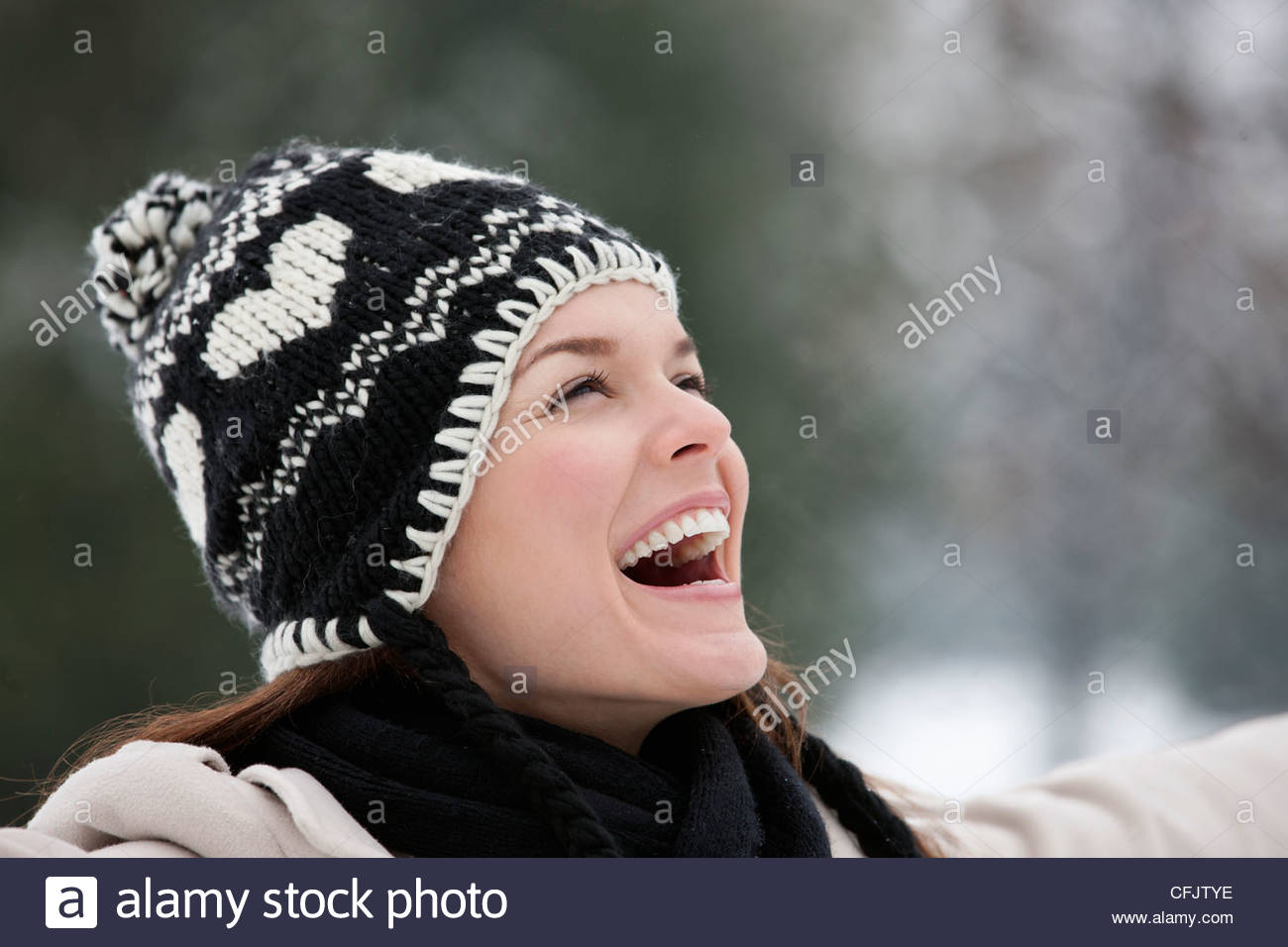 A young woman wearing a woolen hat, enjoying the open air - Stock Image