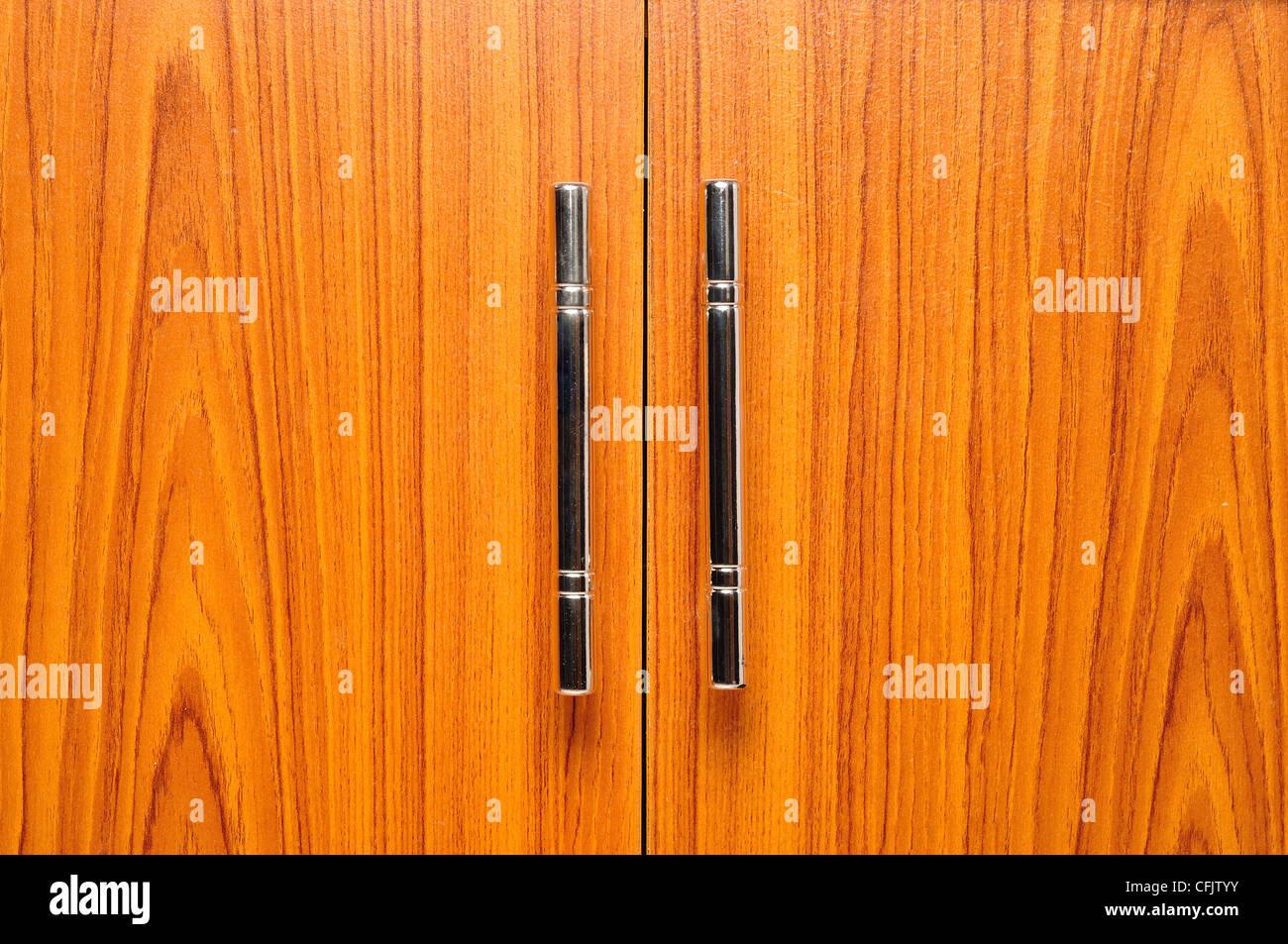 light brown doors with metal handles - Stock Image