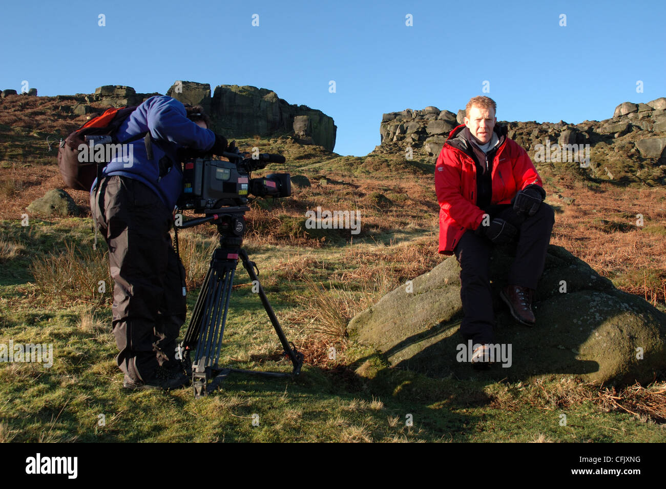 BBC Countryfile presenter Adam Henson and TV crew at Cow and Calf Rocks, Ilkley Moor, Yorkshire - Stock Image