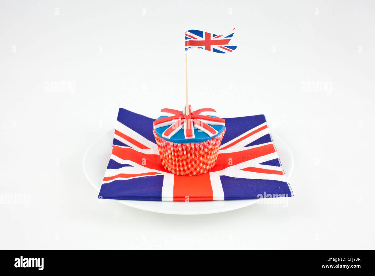 union jack flag cupcakes on a paper napkin and white plate - Stock Image