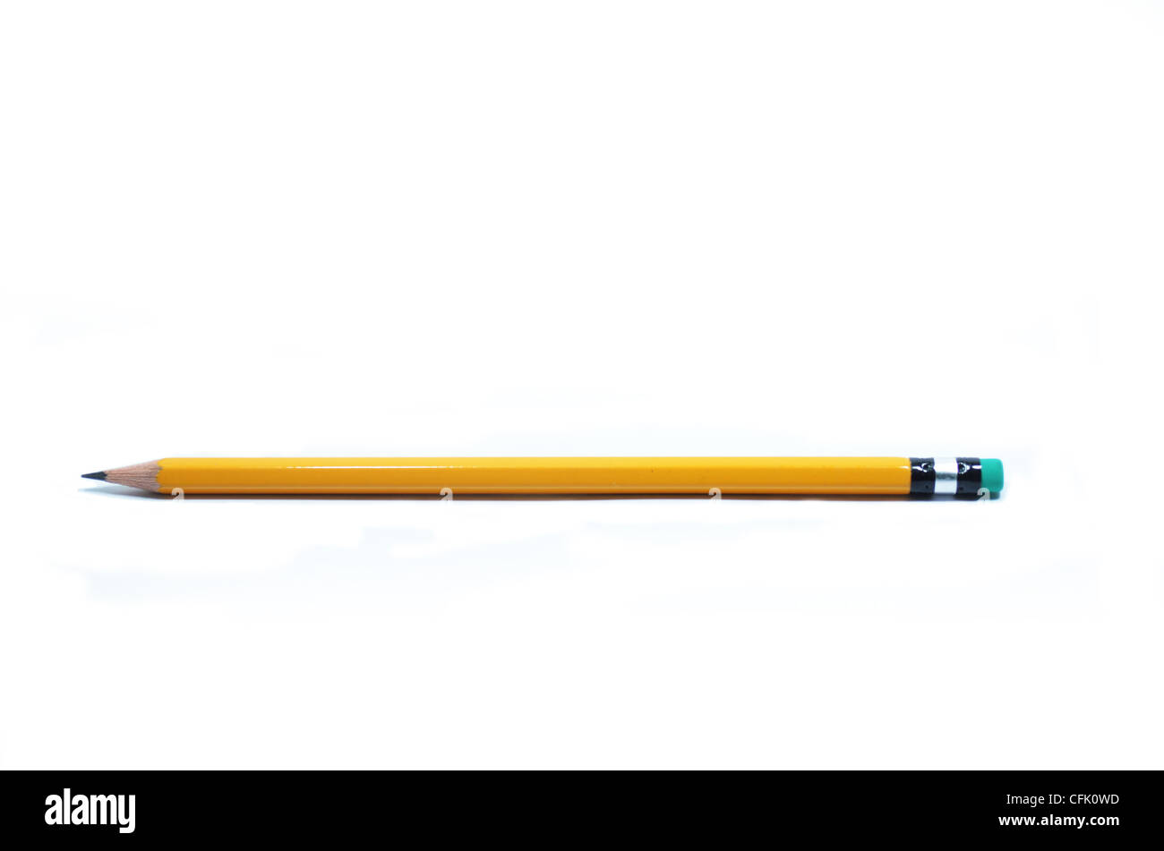 isolated pencil over a white background with green eraser - Stock Image