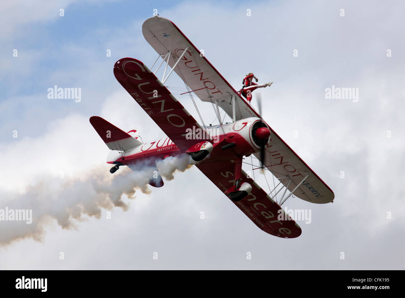 Wing walking on the Guinot biplane formation display team - Stock Image