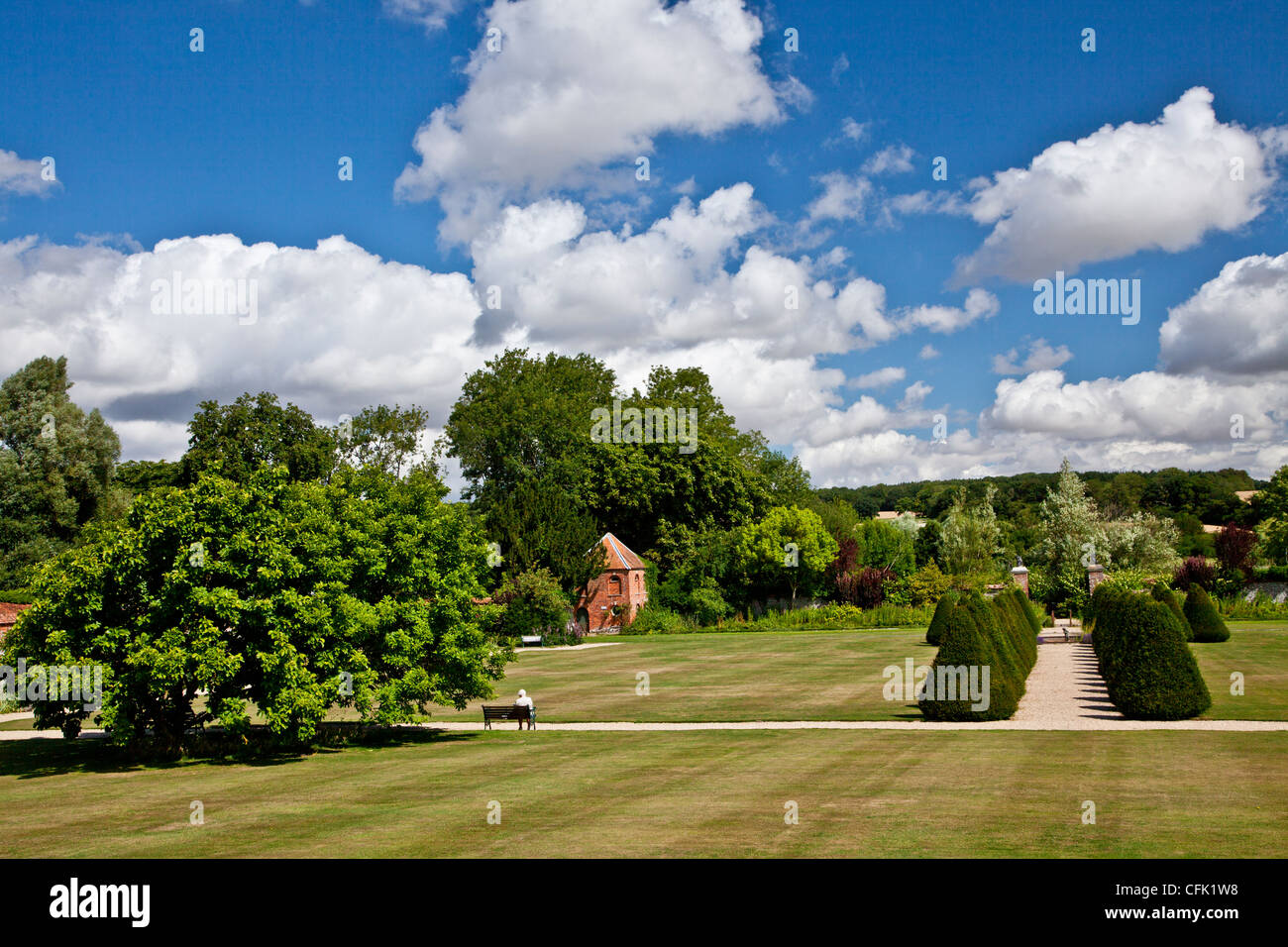 View across the lawn of the English country garden of Littlecote Manor in Berkshire, England, UK - Stock Image