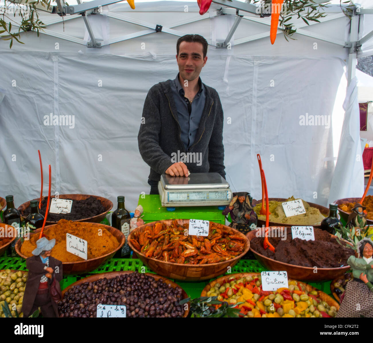 Paris, France, Clerk at Food Stall, French Food and Drink Pubic Market, with Local Products on Display, Street Vendor, - Stock Image