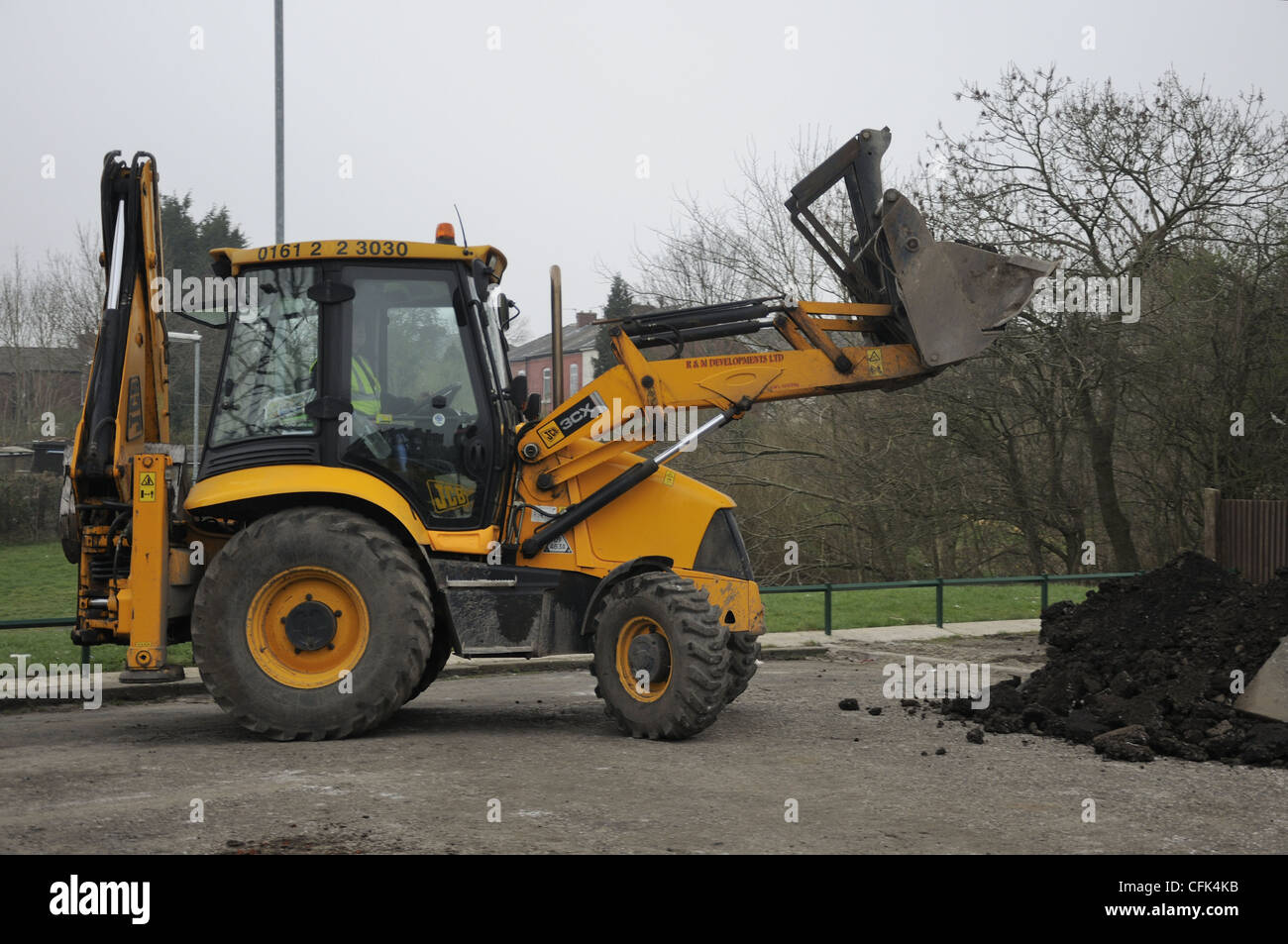 JCB with full bucket load - Stock Image