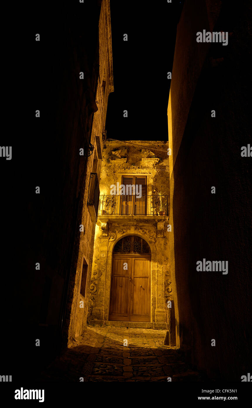 Appartment building at night, Erice, Italy. - Stock Image