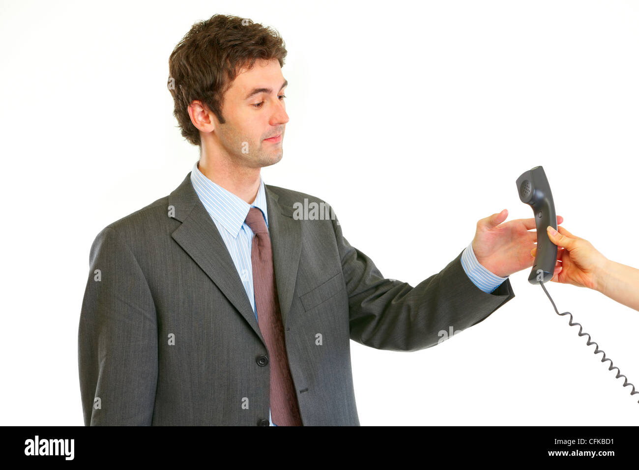 Serious modern businessman taking phone from secretaries hand isolated on white - Stock Image