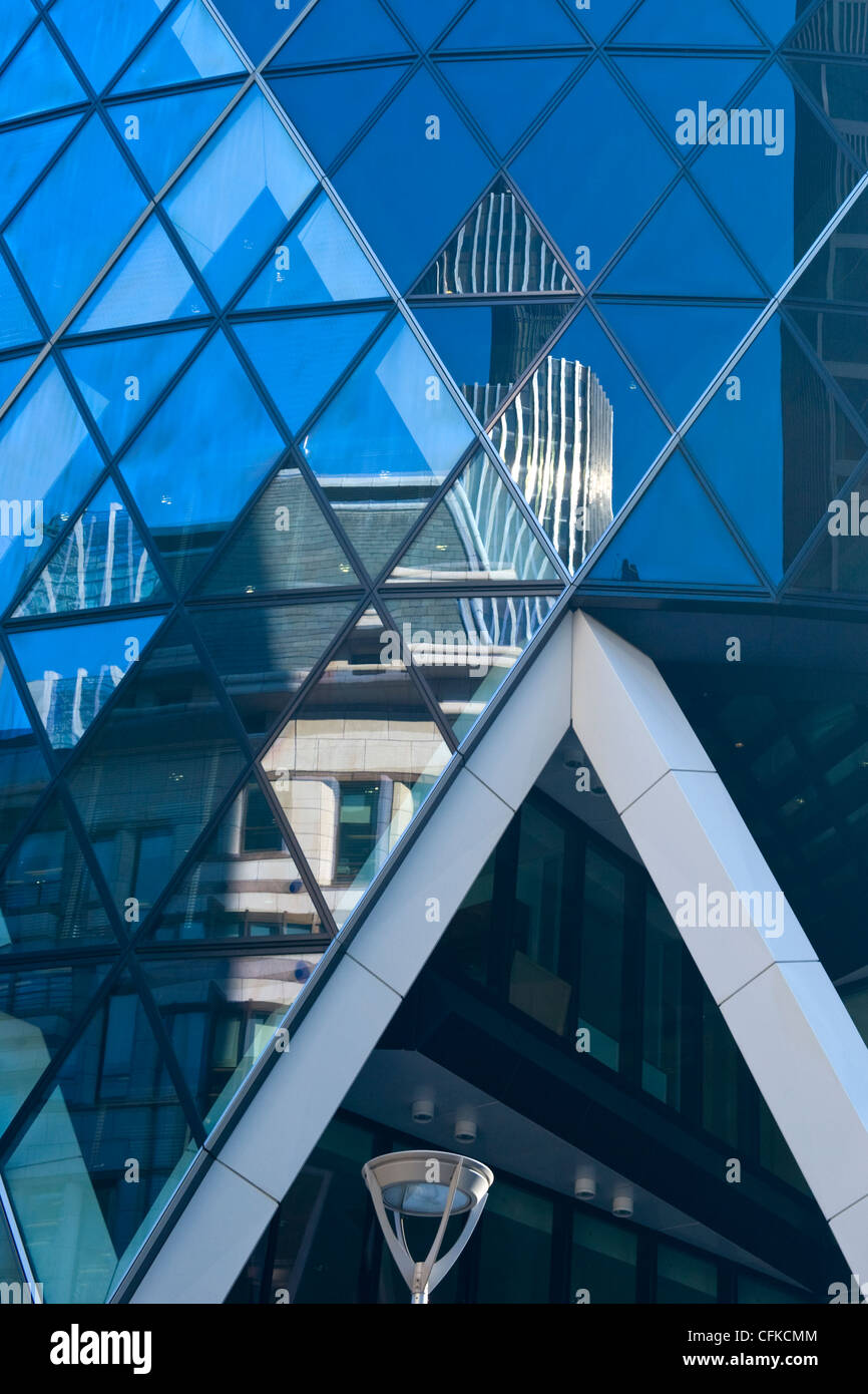 City of London , detail image with reflections in The Gherkin or Swiss Re skyscraper building - Stock Image