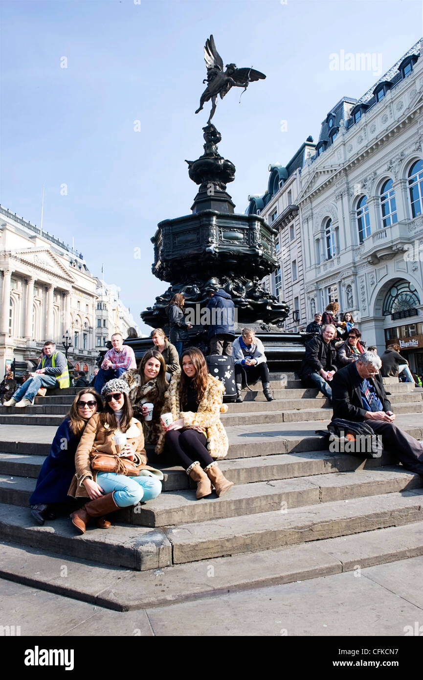 Piccadilly Circus London statue of Eros brother Anteros The God of Selfless Love steps stairs tourists Shaftesbury - Stock Image