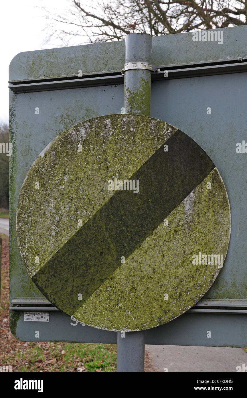 Poorly kept dirty road sign. - Stock Image