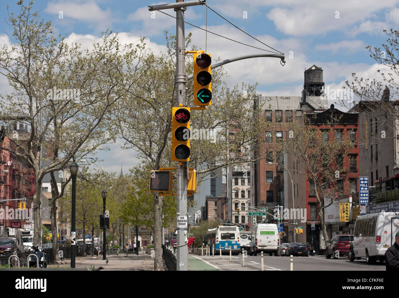 Traffic signals allow left turns while other lanes must stop. - Stock Image