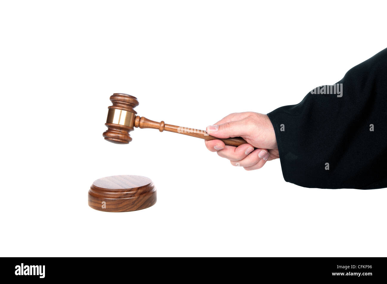 Judge hits a sound block with his gavel. Image is isolated for designer convenience. - Stock Image