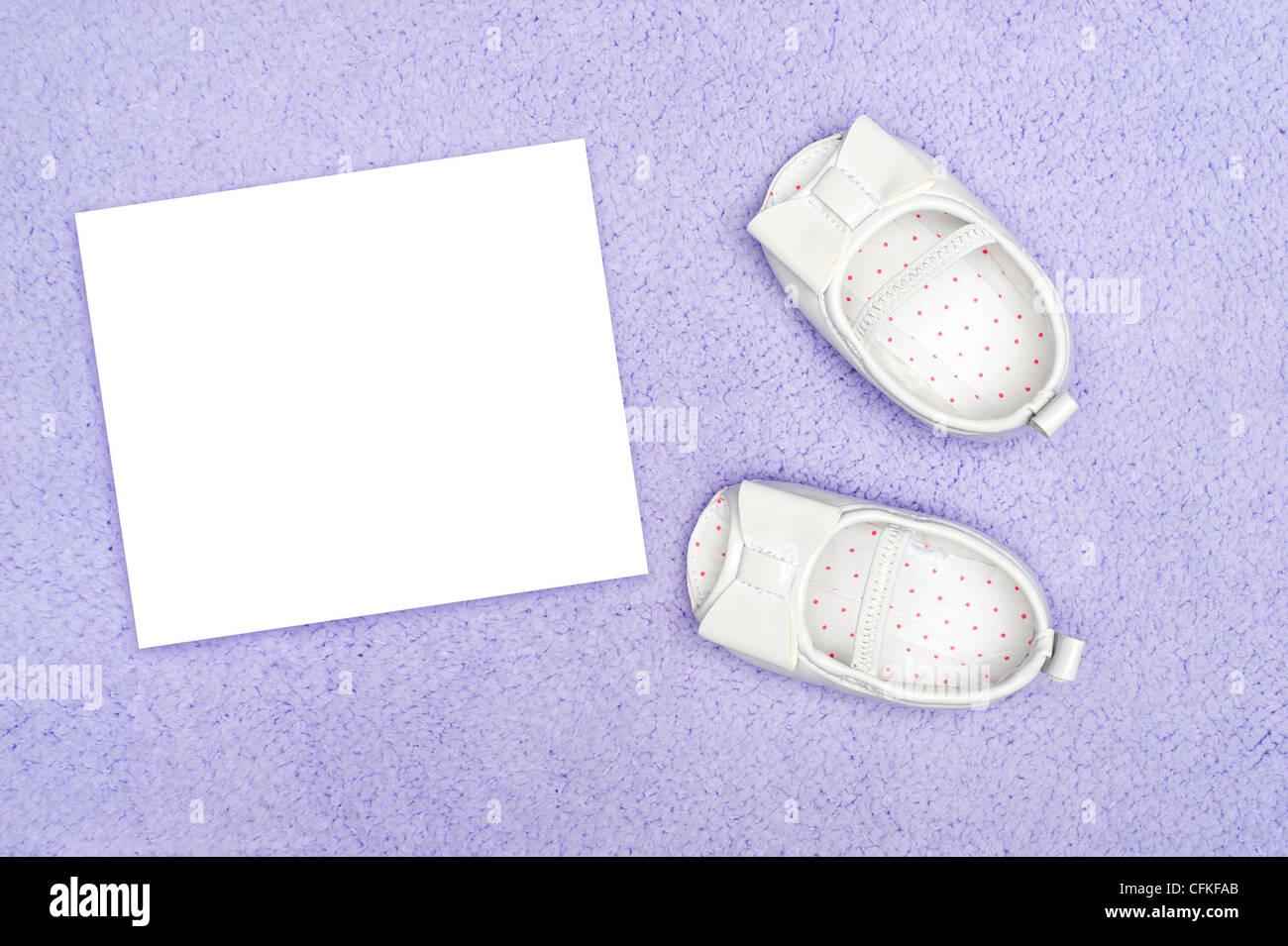 Invitation card formal blank stock photos invitation card formal formal infant dress shoes on purple carpet with blank white card for copy stock stopboris Choice Image