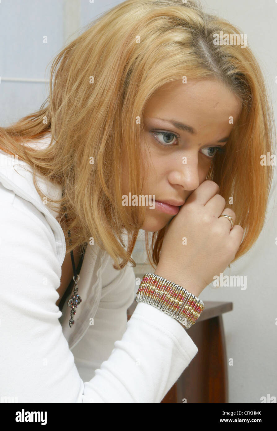 Young woman feeling miserable - Stock Image