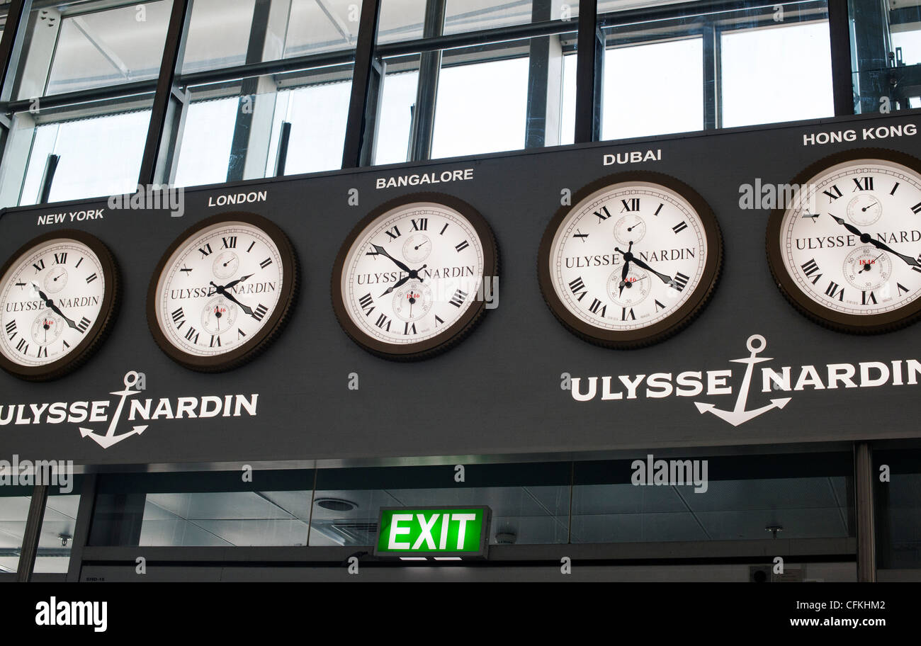 International time clocks in Bangalore (Bengaluru) airport depature lounge. India - Stock Image