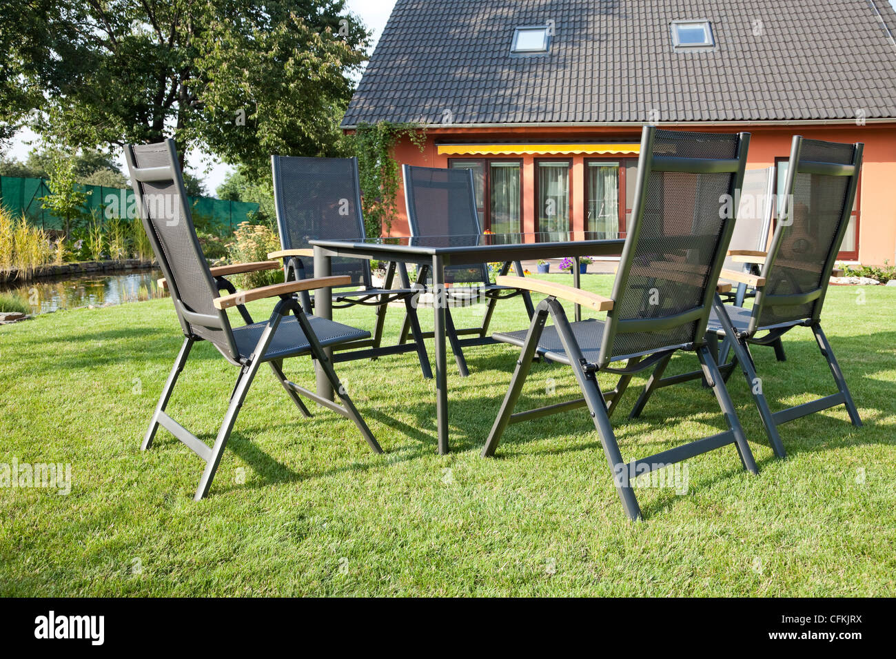 The Metal Garden Furniture By The House And The Pool   Stock Image